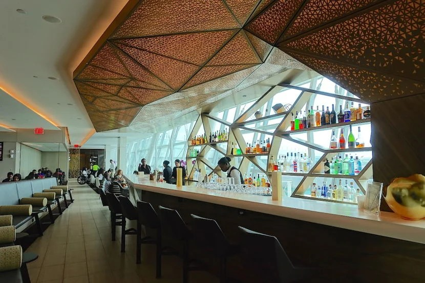 A shot of the bar, which is just beyond a sitting area at the entrance.