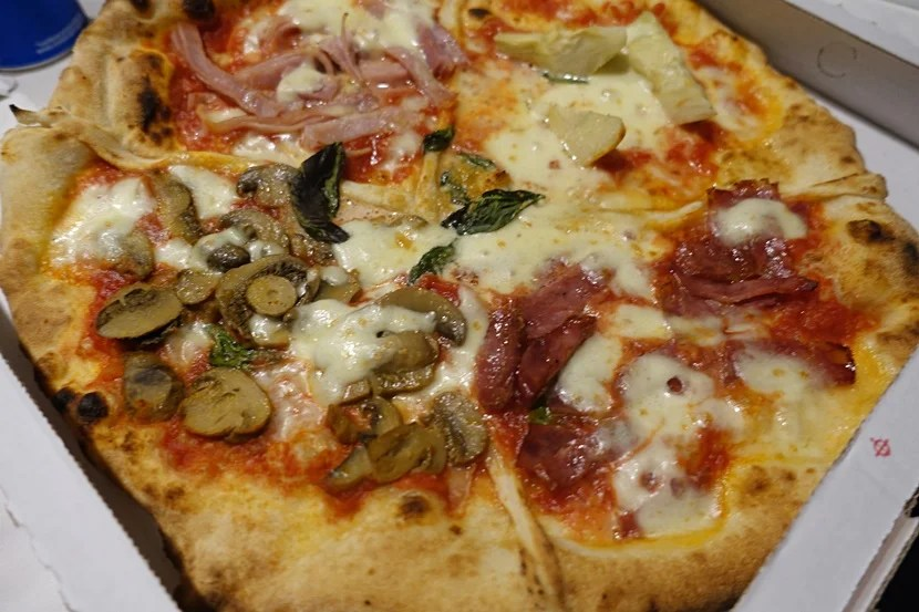 Four seasons pizza in Naples.