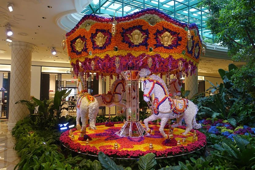 The flower-covered carousel brought some imagination to the property.