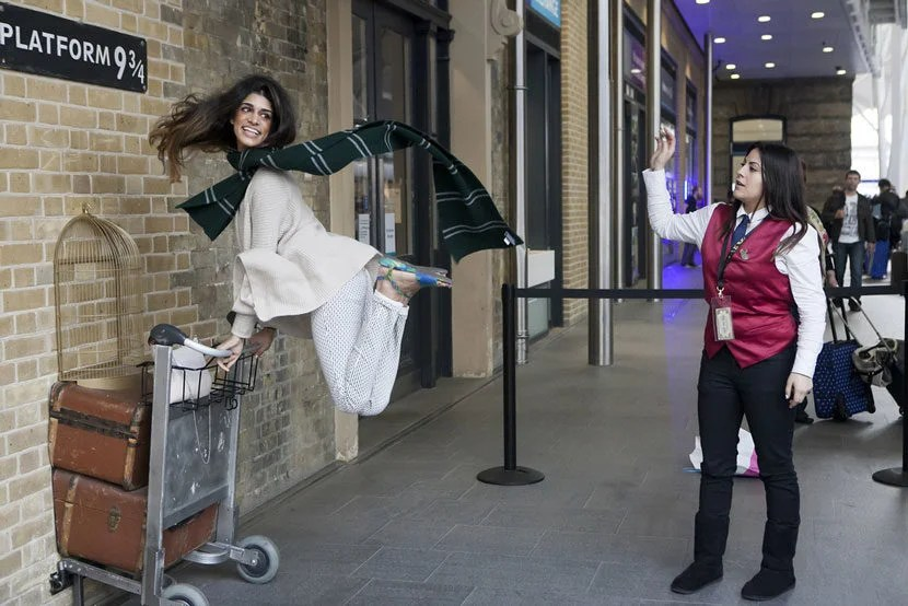 "Be prepared to wait in line to take your picture pushing luggage through the magical barrier at the new Platform 9 3/4. Image courtesy of <a href=""http://www.shutterstock.com/pic-290582168/stock-photo-london-uk-mar-kings-cross-station-wall-visited-by-fans-of-harry-potter-to-photograph.html?src=P5wgE0m7EfRxV7uUpEpARA-1-47"" target=""_blank"">Shutterstock</a>."