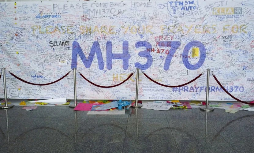 """The search for MH370 will soon be suspended indefinitely. Image courtesy of <a href=""""http://www.shutterstock.com/pic-182049074/stock-photo-kuala-lumpur-international-airport-march-support-messages-and-prayers-for-malaysia.html?src=f6tchrbcwdXptCAr-xGkKg-1-3"""" target=""""_blank"""">Shutterstock</a>."""