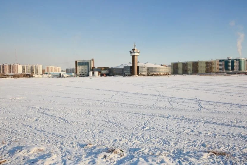 "Yakutsk is a frozen tundra most of the year. Image courtesy of <a href=""http://www.shutterstock.com/pic-349092833/stock-photo-winter-urban-landscape-with-a-lake-on-a-clear-day.html?src=xyTDELuVUND8QmzbTNiIUQ-1-3"" target=""_blank"">Shutterstock</a>."