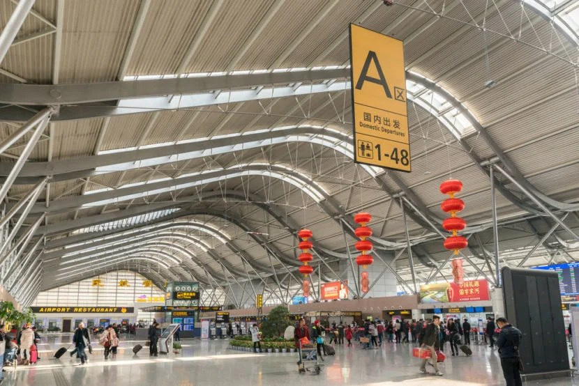 "China's airports are very modern but perpetually delayed. Image courtesy of <a href=""http://www.shutterstock.com/downloading_tips.mhtml?code=&id=410924290&size=medium&image_format=jpg&method=download&super_url=http%3A%2F%2Fdownload.shutterstock.com%2Fgatekeeper%2FW3siZSI6MTQ2OTg2NjU0NSwiYyI6Il9waG90b19zZXNzaW9uX2lkIiwiZGMiOiJpZGxfNDEwOTI0MjkwIiwiayI6InBob3RvLzQxMDkyNDI5MC9tZWRpdW0uanBnIiwibSI6IjEiLCJkIjoic2h1dHRlcnN0b2NrLW1lZGlhIn0sIlNDQSsrb05WVTZ0ZStYYzZzaVBUV09aOFVLZyJd%2Fshutterstock_410924290.jpg&racksite_id=ny&chosen_subscription=1&license=standard&src=qIoA3dBE21o6zUNSt0xL1g-1-22"">Shutterstock</a>."
