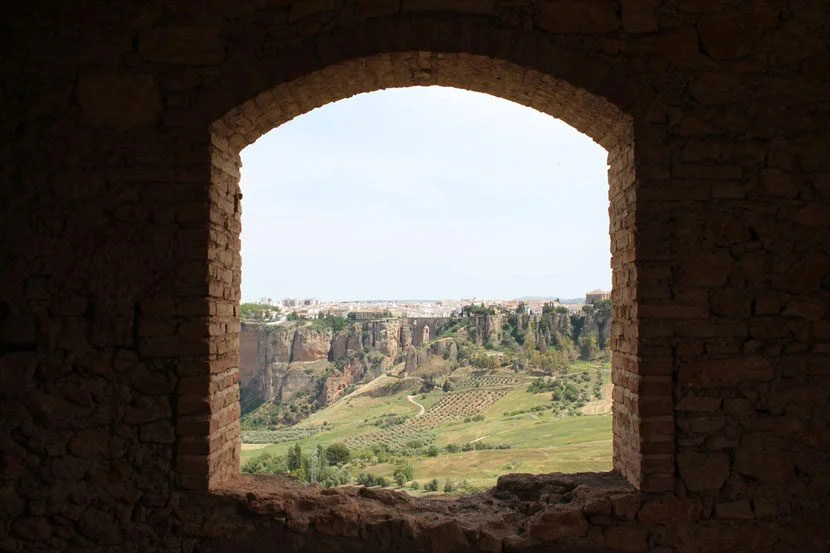 A view of Ronda, Spain from a deserted building in the surrounding countryside (taken May, 2015).