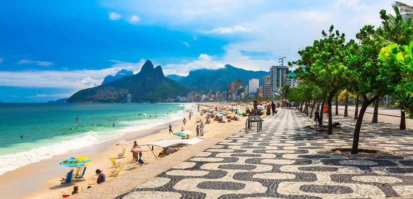 Featured image of Ipanema Beach and the Rio's world-famous mosaic sidewalk courtesy of Shutterstock.