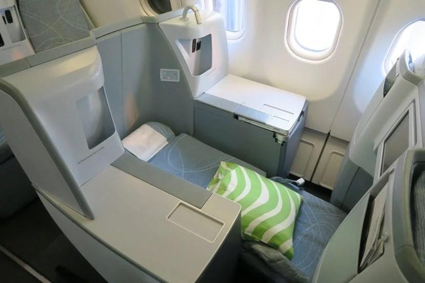 Each business class seat reclines into a lie-flat bed.