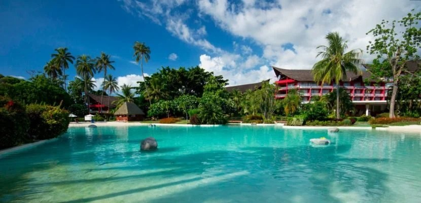 The beautiful pool and lush tropical landscaping at Le Meridien Tahiti