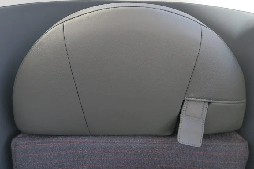 Each business class seat has a shoulder belt, which some found confusing to use.