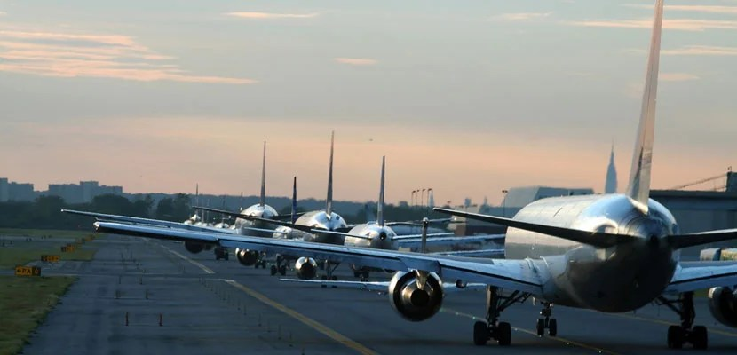 Airplanes lined up at JFK. Image courtesy of Shutterstock.
