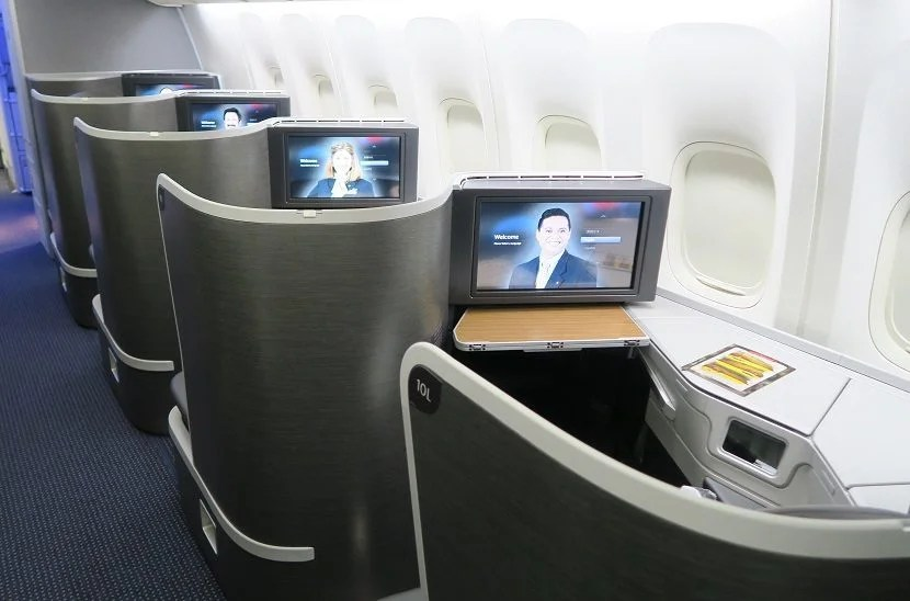 Window business class seats from the rear.