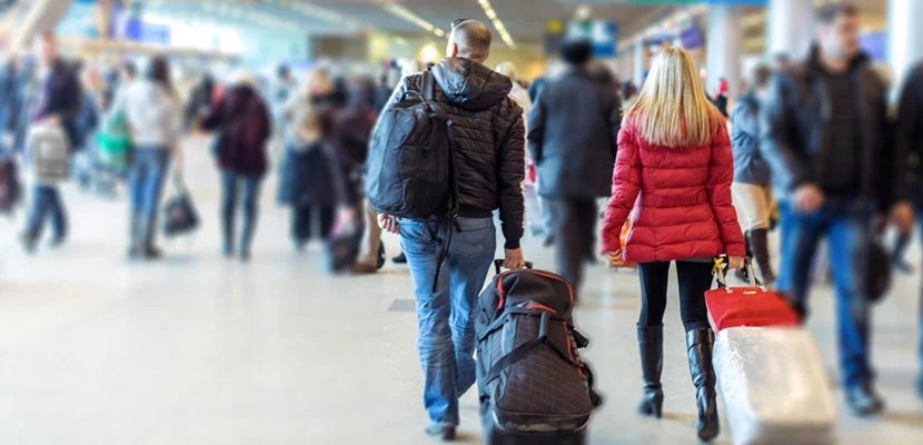 Crowds of people at the airport. Image courtesy of Shutterstock.