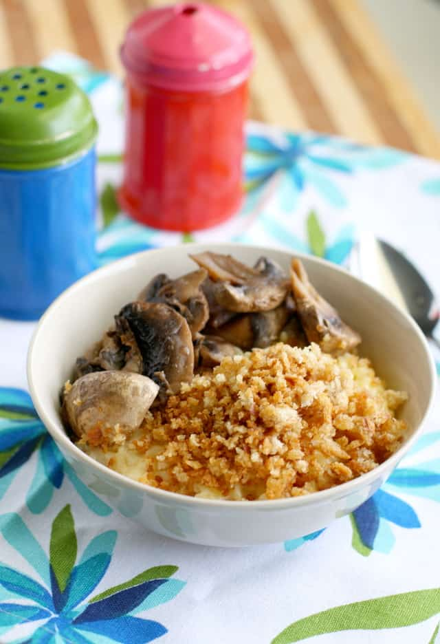 Savory mushrooms and buttered breadcrumbs top this bowl of creamy orzo. A tasty lunch or dinner. #vegan