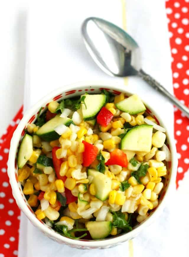 Delicious and colorful corn and zucchini salad is gluten free and easy to make. A fresh and healthy salad for a picnic!