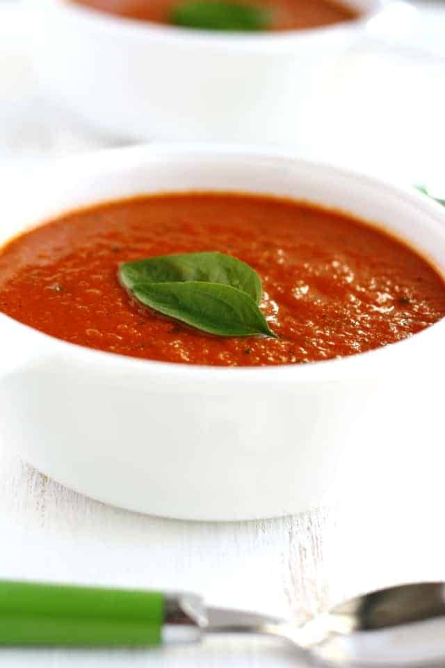 This tomato basil soup is rich, creamy, and easy to make. A great way to use up your garden tomatoes! Dairy free and gluten free recipe.