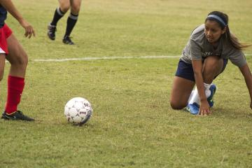 Lauren Marquez regains her footing after performing a slide tackle against Hill College.