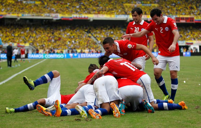 Chilean players celebrate a goal from Sanchez during their 2014 World Cup qualifying soccer match against Colombia in Barranquilla