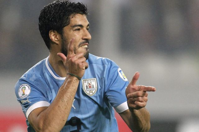 Uruguays-Suarez-celebrates-after-scoring-against-Peru-during-their-2014-World-Cup-qualifying-soccer-match-in-Lima
