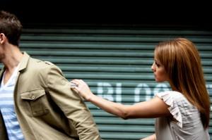 woman chasing man