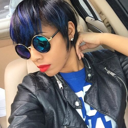 very short black bob with color accents