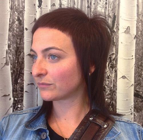 medium layered haircut with extra short bangs