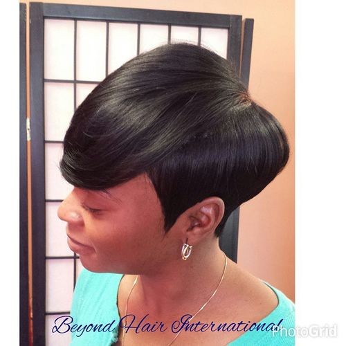 short black voluminous hairstyle with long bangs