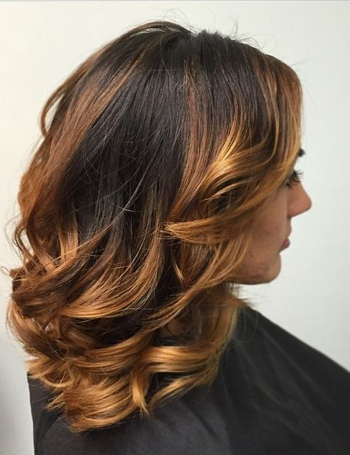 medium brunette layered hairstyle with golden brown balayage