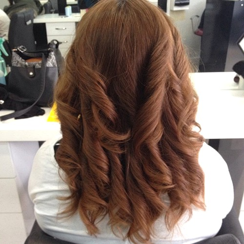 chestnut brown curly hairstyle