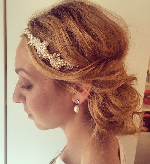 red messy low updo with a jeweled headband