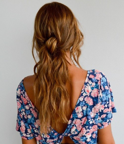 Low Messy Ponytail For Long Layered Hair