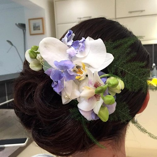 side updo with hair flowers for prom