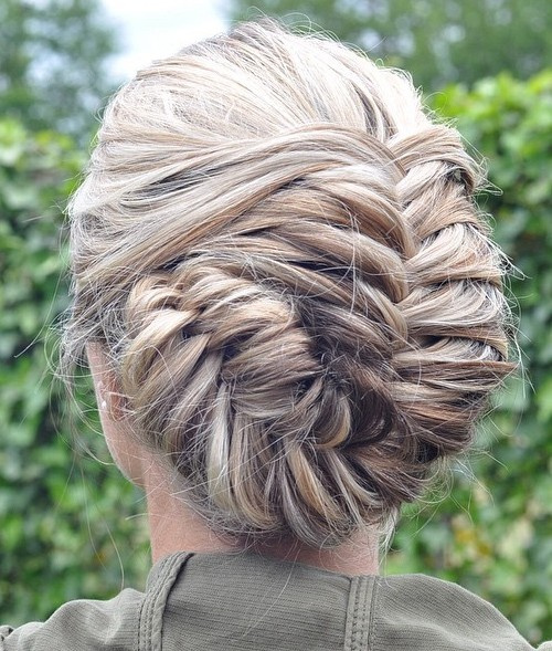 asymmetrical blonde fishtail updo