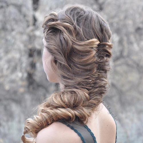 loose chunky fishtail braid hairstyle