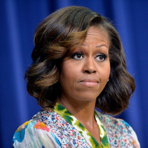 Michelle Obama medium curly hairstyle for women over 50