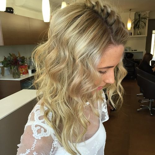 wavy hairstyle with a braid