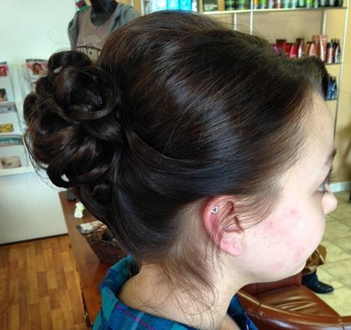 formal curly bun for medium hair