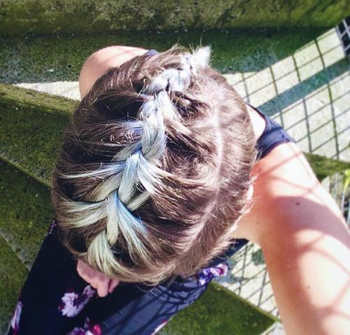 braided long top short sides hairstyle for prom
