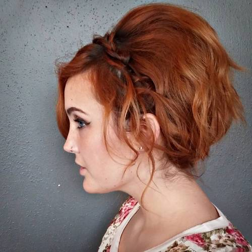 red tousled hairstyle with a headband braid