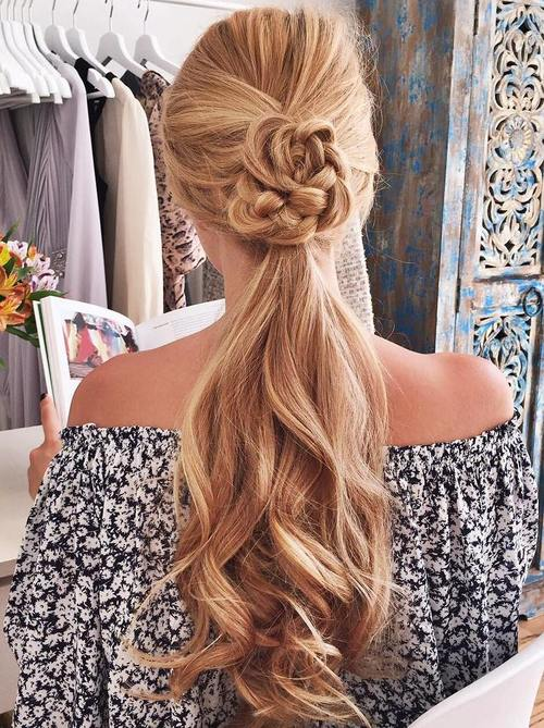 long ponytail hairstyle with a braided detail
