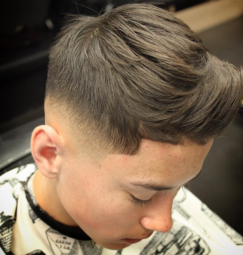 Fade Haircut With Layered Top For Boys