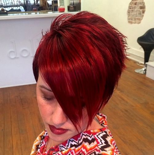 short asymmetrical red haircut with long bangs