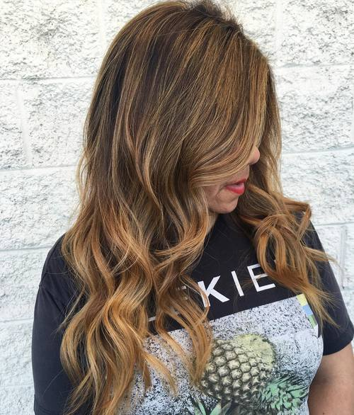 long wavy side part hairstyle