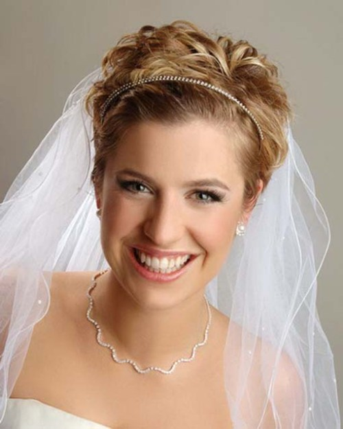 short wedding hairstyle with a bridal veil