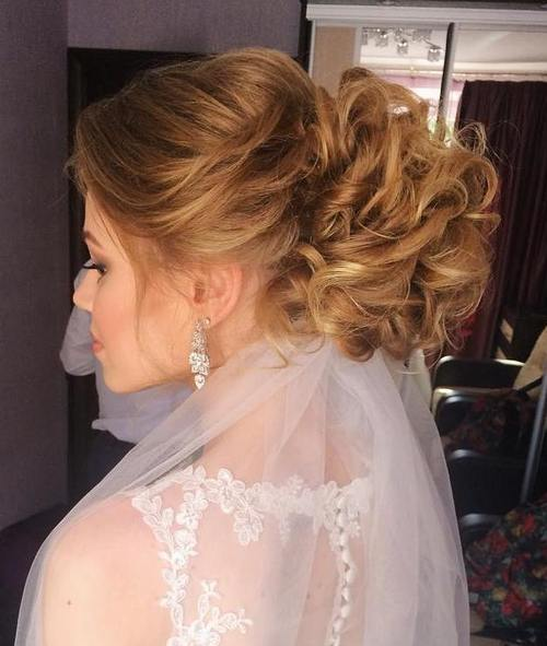 curly voluminous updo for brides