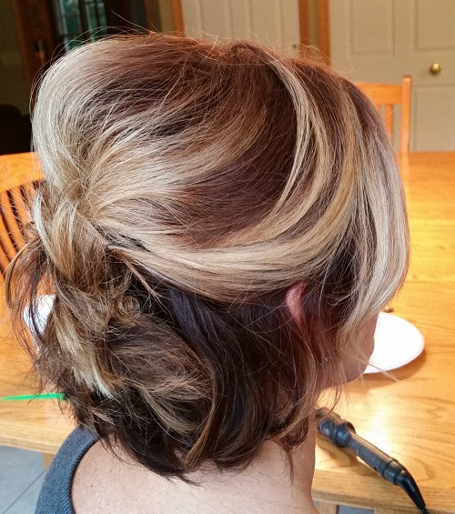 half updo with a bouffant for shorter hair