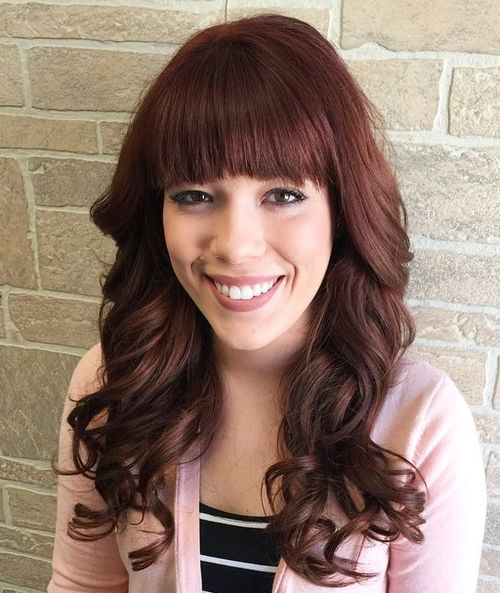 curly burgundy hair with bangs