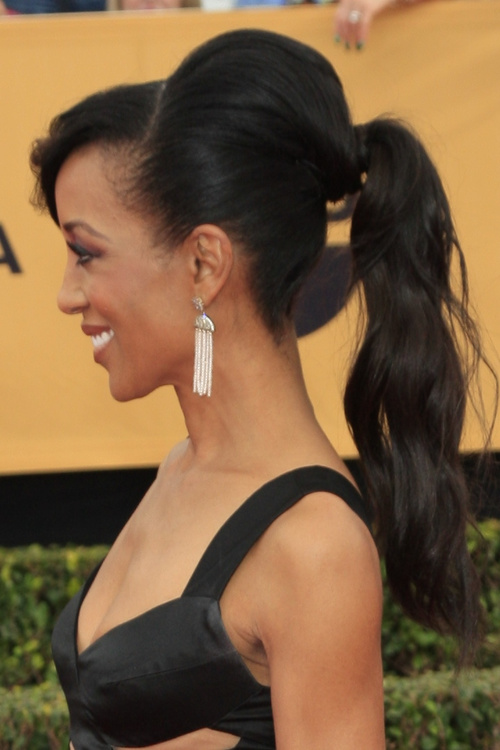 ponytail black hairstyle with bangs