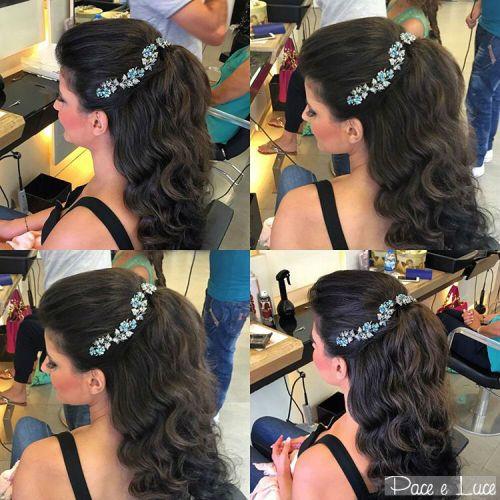wavy half up hairstyle with jeweled headband