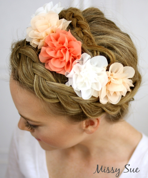 crown braid hairstyle with hair flowers