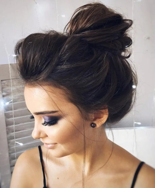 Voluminous Messy Bun With Teased Roots