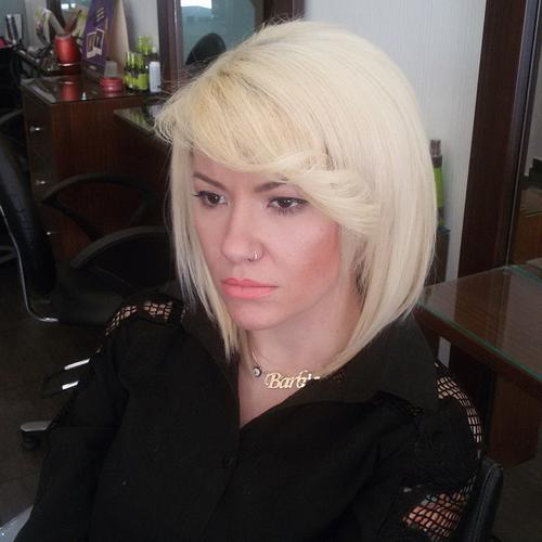 blonde bob with flipped out side bangs
